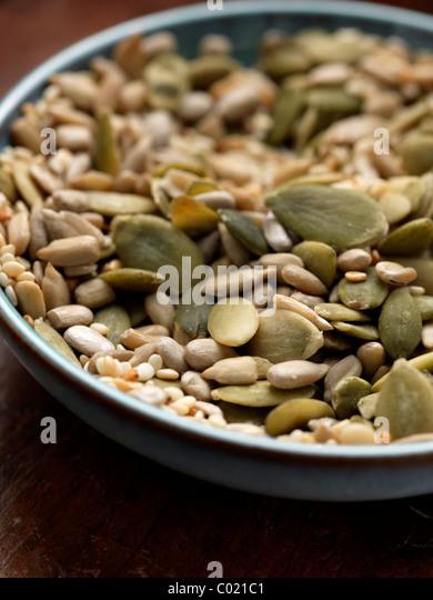 Blue bowl of various seeds mixture - Stock Image