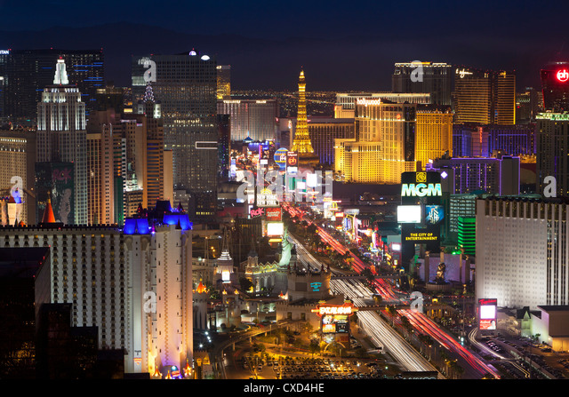Elevated view of the hotels and casinos along The Strip at dusk, Las Vegas, Nevada, United States of America, North - Stock Image