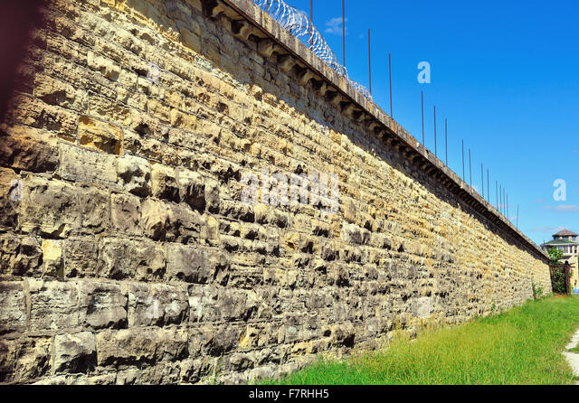 Wall and distant guard tower at the Joliet Correctional Center (also known as Illinois State Penitentiary and Joliet - Stock Image