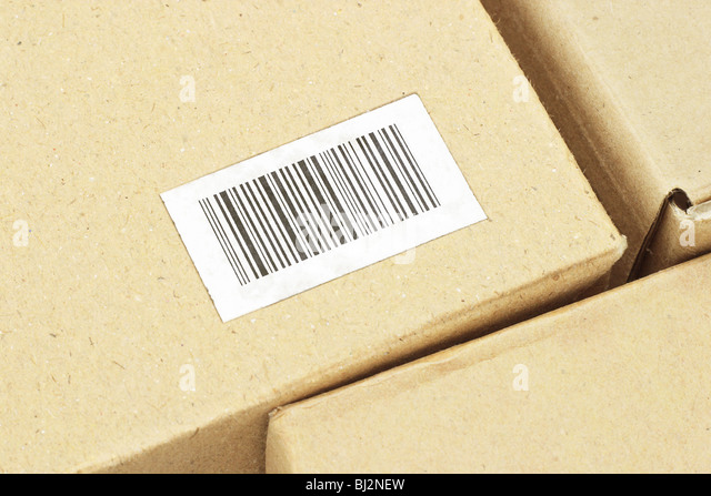 Close up of bar code label on carton box (bar code randomly created) - Stock Image