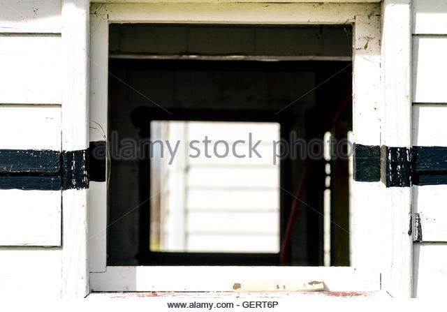 White rustic wood wall with window - Stock Image