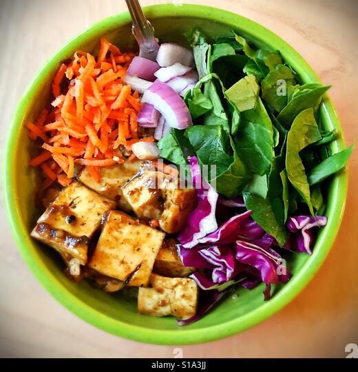 A tofu and vegetable quinoa bowl. - Stock Image