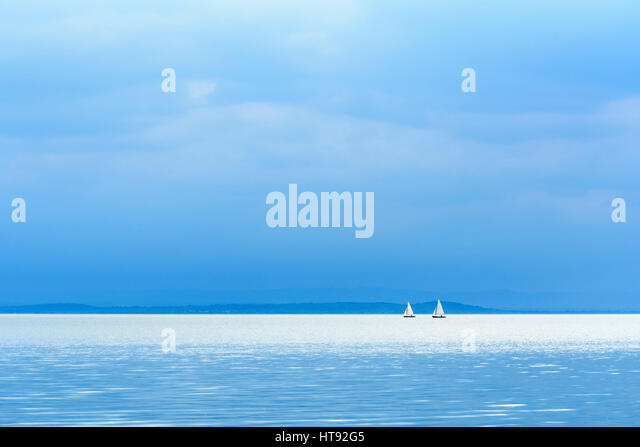 Lake with Sailboats, Weiden, Lake Neusiedl, Burgenland, Austria - Stock Image