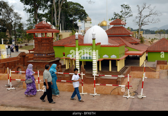 Malay or Malaysian Family Visiting Model of Kudus Minar Mosque at Islamic Civilization Theme Park, Kuala Terengganu, - Stock Image