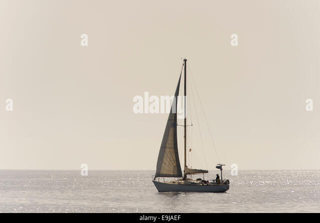 Sailing ship at sea on a still calm day. - Stock Image