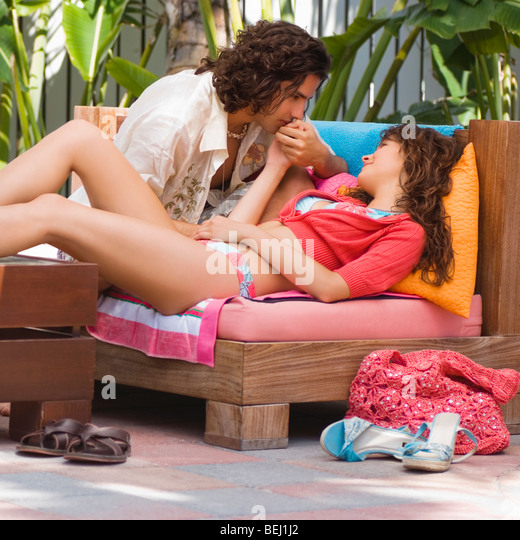 Young couple sitting on a couch and romancing - Stock-Bilder