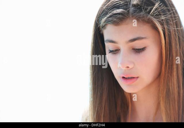 Portrait of brunette teenage girl looking down - Stock-Bilder