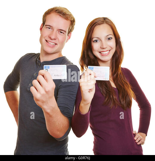 Two happy teenager showing their German drivers licence - Stock Image