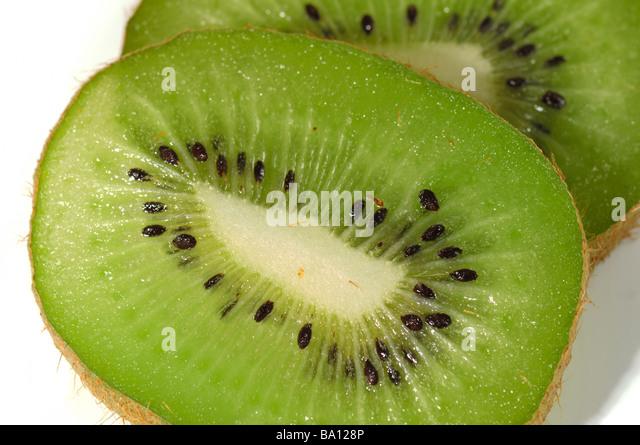 kiwi fruit isolated on the white background macro - Stock Image