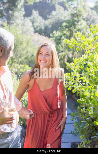 Couple having champagne together outdoors - Stock Image