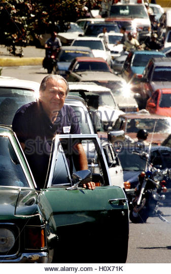 A man waits in line for gas in Caracas, January 27, 2003. Venezuelan  opposition forces debated scaling back its - Stock Image