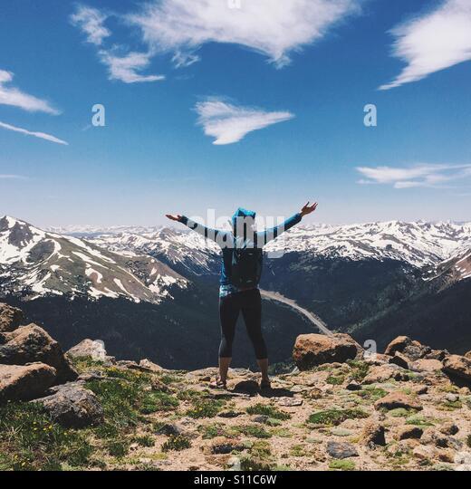 Mountaintop Hiker - Stock Image