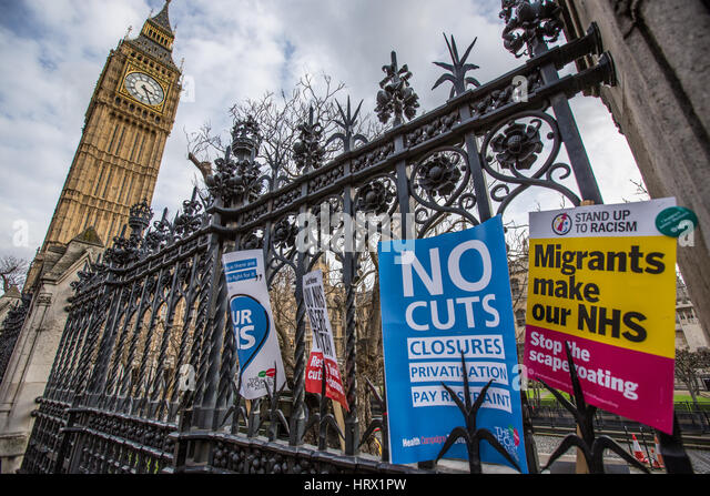 London, UK. 4 March, 2017. Placards left on the railings outside Parliament after thousands marched through London - Stock Image