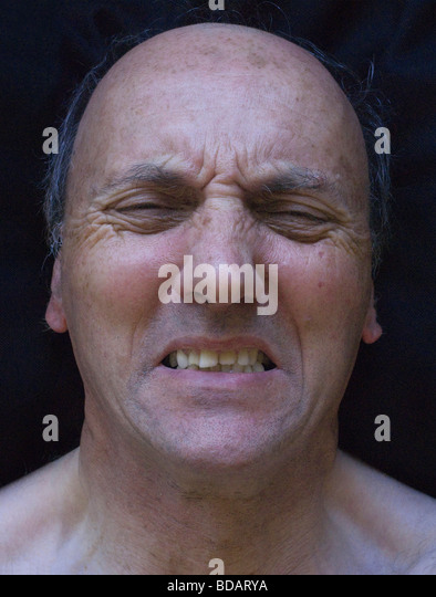 A middle-aged man showing stress, tension and depression - Stock Image