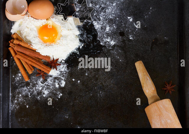 baking ingredients on black - Stock Image