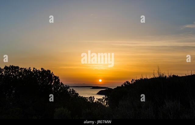 Wonderful orange sunrise over Sardinia, Italy - Stock Image