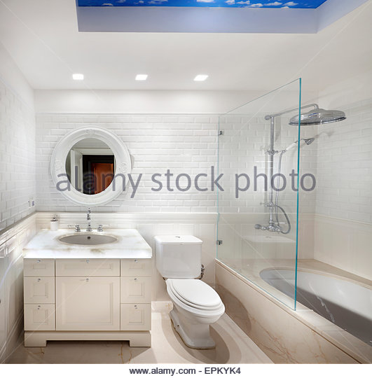 Bathroom with glass screened bath in villa in Savion, Israel. - Stock Image