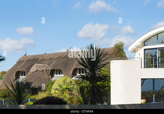 Contrasting traditional and modern architecture at Christchurch, Dorset in September - Stock Image
