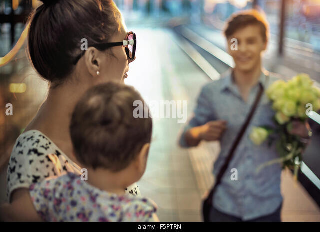 Happy family on a railway station - Stock Image