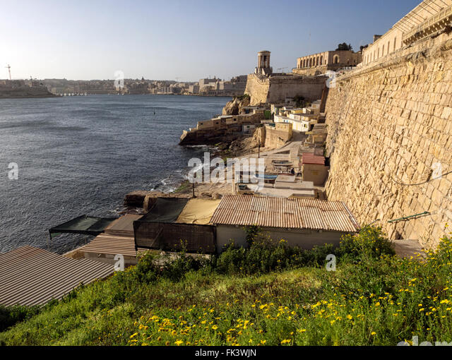 Harbour front in Valletta, Malta, with the bell tower World War Two siege memorial in the background - Stock Image