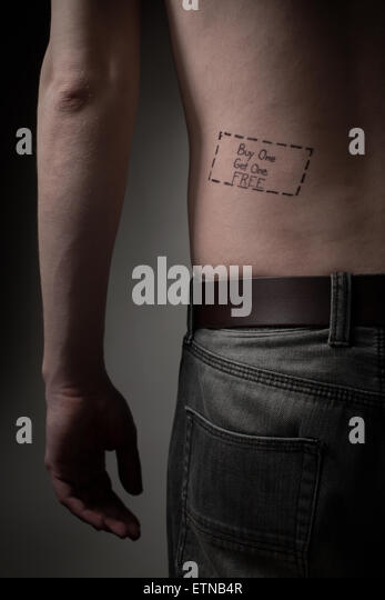Man with a buy one get one free tattoo on his back - Stock Image