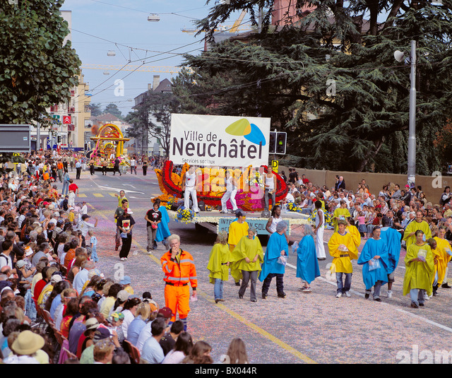 party of Vendanges vintage festival relocation move parade Switzerland Europe Neuchatel Neuenburg spectator - Stock Image