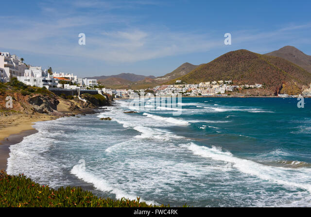 Beach San Jose white village, Almeria, Andalucia Spain fishing port Parque Natural de Cabo de Gata park - Stock Image