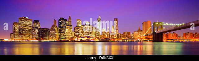 New York City panorama with the Brooklyn Bridge and the Financial district from across the East River. - Stock Image