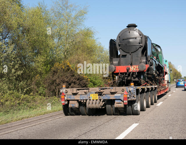 Locomotive steam train being transported by road 2015 - Stock Image