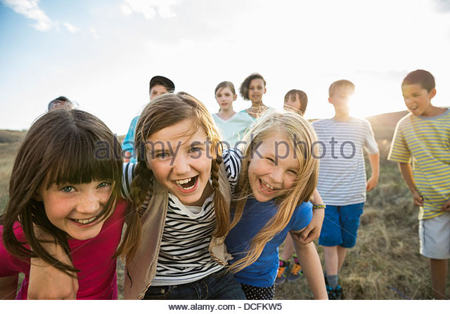 Group portrait of kids having fun outdoors - Stock Image