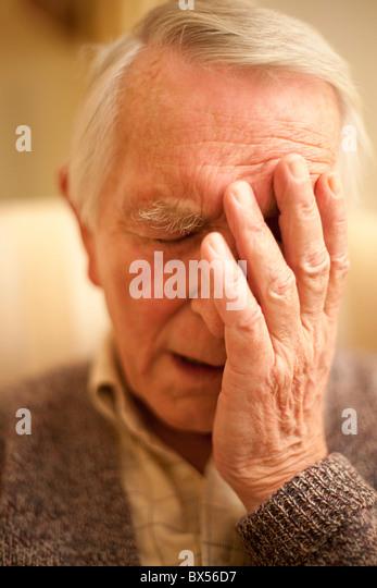 Depressed senior man - Stock Image
