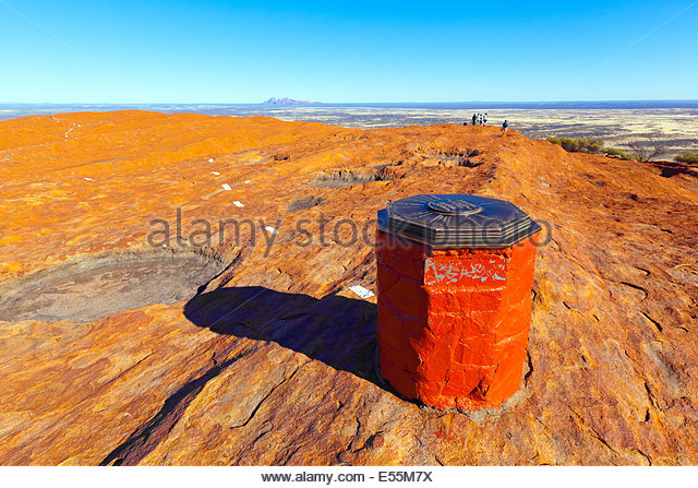 outback landscape red rock people hiking Uluru Ayers Central Australia Northern Territory Australia Australian - Stock Image
