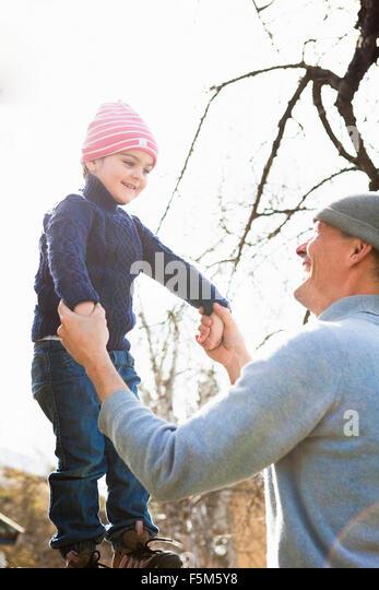 Sweden, Sodermanland, Huddinge, Stuvsta, Father and son (4-5) outdoors - Stock Image