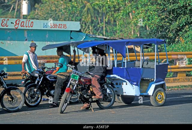 Dominican Republic Samana Peninsula Santa Barbara de Samaná moto concho motoconcho - Stock Image