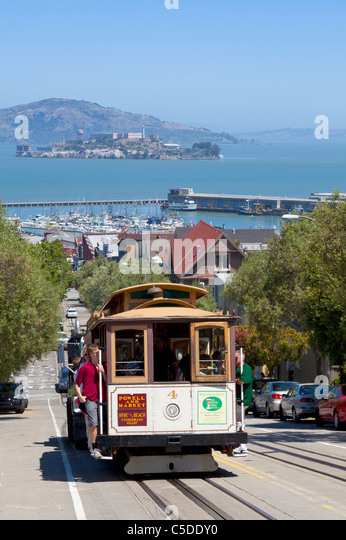 san francisco cable car with Alcatraz island in the bay behind California USA United States of America - Stock Image