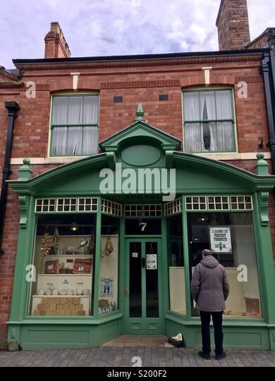 Elaborate Victorian shopfront, painted green, grocers shop, Blists Hill, Shropshire, England - Stock Image