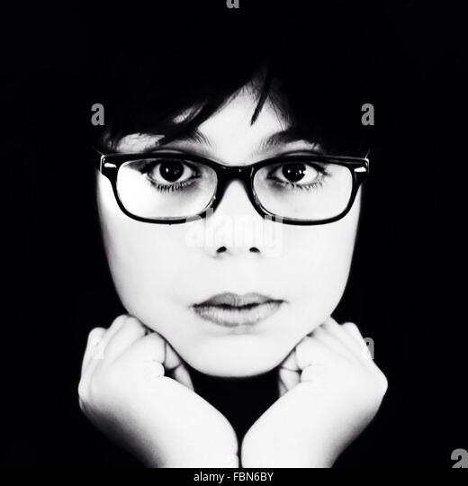Close-Up Portrait Of Young Woman Wearing Eyeglasses Over Black Background - Stock-Bilder