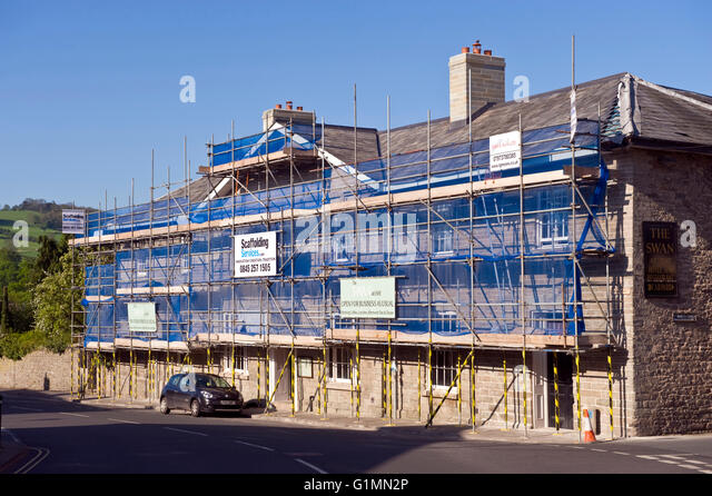 The Swan Hotel at Hay-on-Wye Powys Wales UK. A Georgian Grade II listed building covered in scaffolding while undergoing - Stock Image