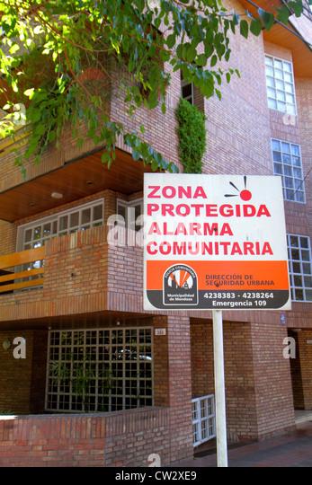 Argentina Mendoza Avenida Emilio Civit neighborhood watch security community alarm sign Spanish language public - Stock Image