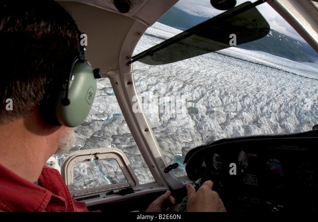 Flight seeing trip with small air plane plane over the Knik River valley towards Knik River Glacier, Palmer, Alaska, - Stock Image