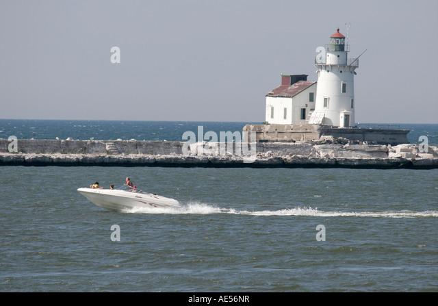 Cleveland Ohio Lake Erie Wendy Park Harbor West Pierhead Lighthouse boat - Stock Image