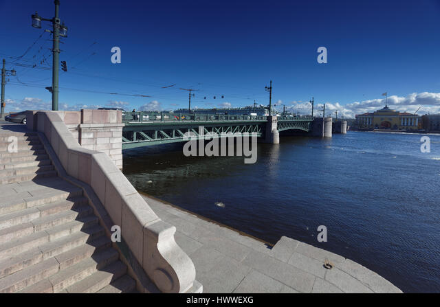 St. Petersburg, Russia, 23rd March, 2017. Palace bridge in a sunny day during the first Ice drift on the river Neva - Stock Image