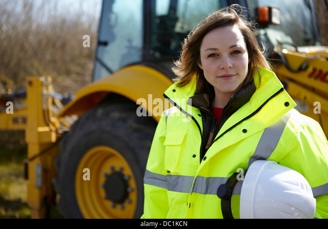 Portrait of female project manager on construction site - Stock-Bilder