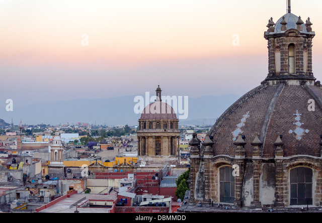 Church domes and cityscape in Mexico City - Stock Image