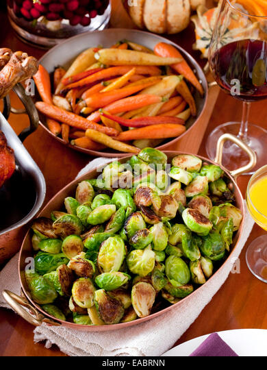 Brussels Sprouts cooked carrots thanksgiving meal holiday family wine table dinner - Stock-Bilder