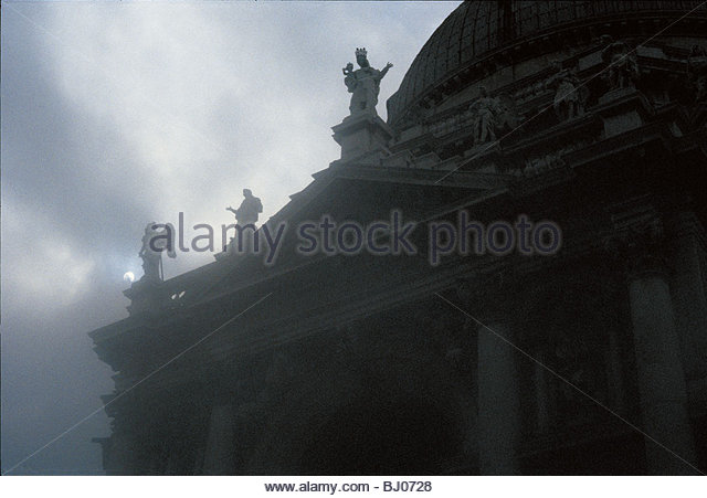 Statues on the roof of the Basilica of Santa Maria della Salute, Venice. Italy - Stock-Bilder