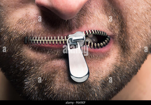 Insubordinate man with zipped mouth - Stock Image