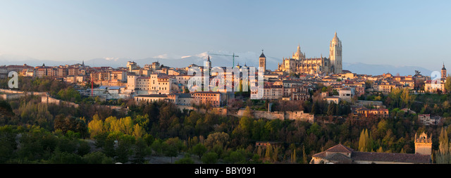 Segovia castle and Cathedral surounded by snow capped mountains, Segovia, Spain - Stock Image