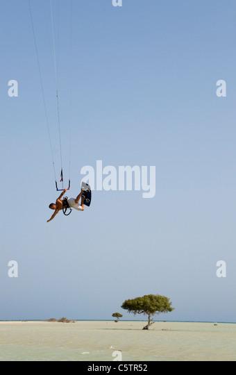 Egypt, Kitesurfer in midair - Stock Image