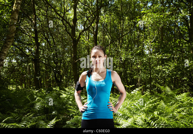 Runner standing in forest - Stock Image